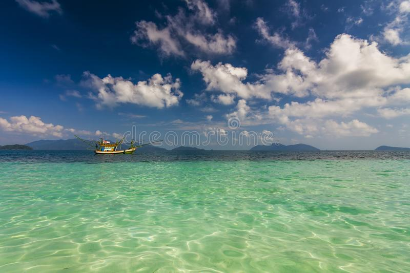 Boat floating at coast of a tropical island. Koh Chang. Thailand.  stock photo