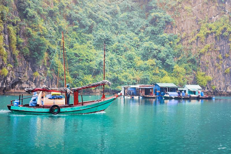 Boat at floating fishing village of Ha Long Bay Asia royalty free stock photos