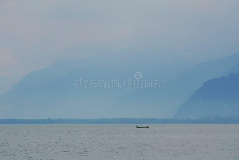 Boat floating on Geneva lake in Montreux Switzerland. Motor boat floating on Geneva lake in Montreux Switzerland royalty free stock images
