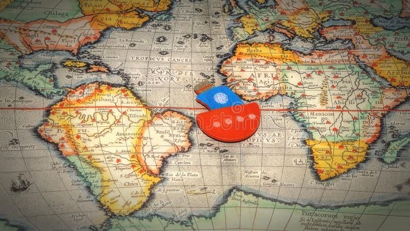 Boat floating on the world map stock photos