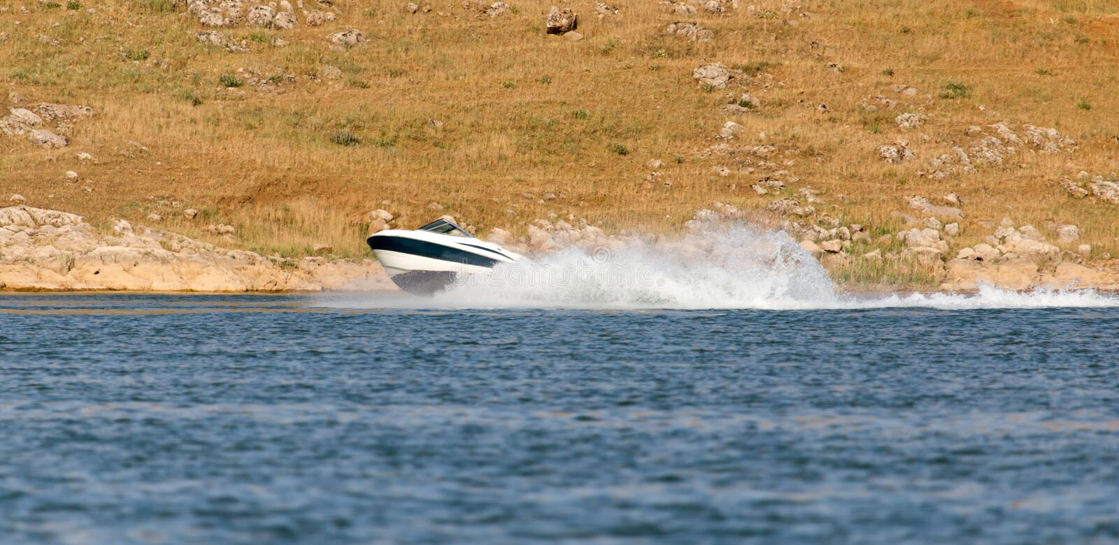 Boat floats on the lake speed.  stock photography