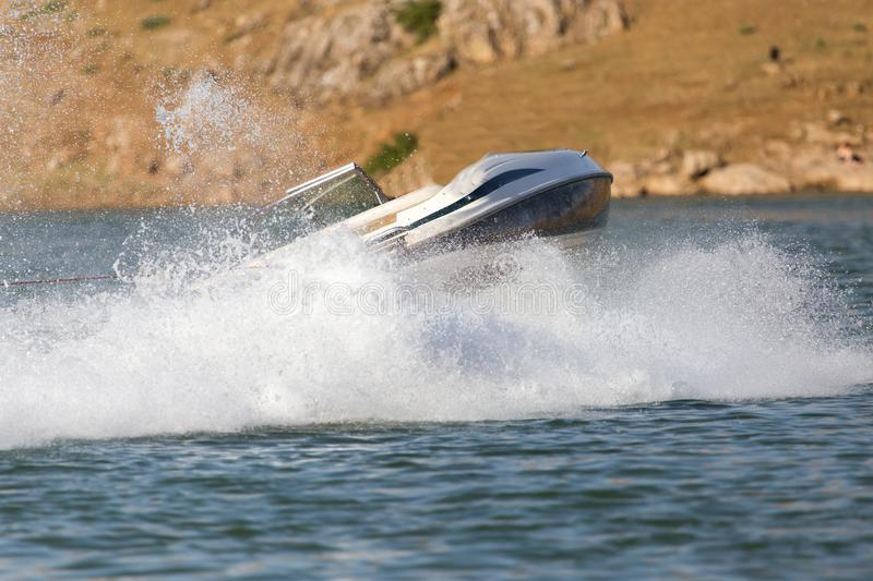Boat floats on the lake speed. In the park in nature stock photography