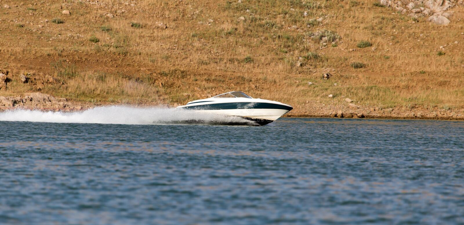 Boat floats on the lake speed. In the park in nature royalty free stock photo