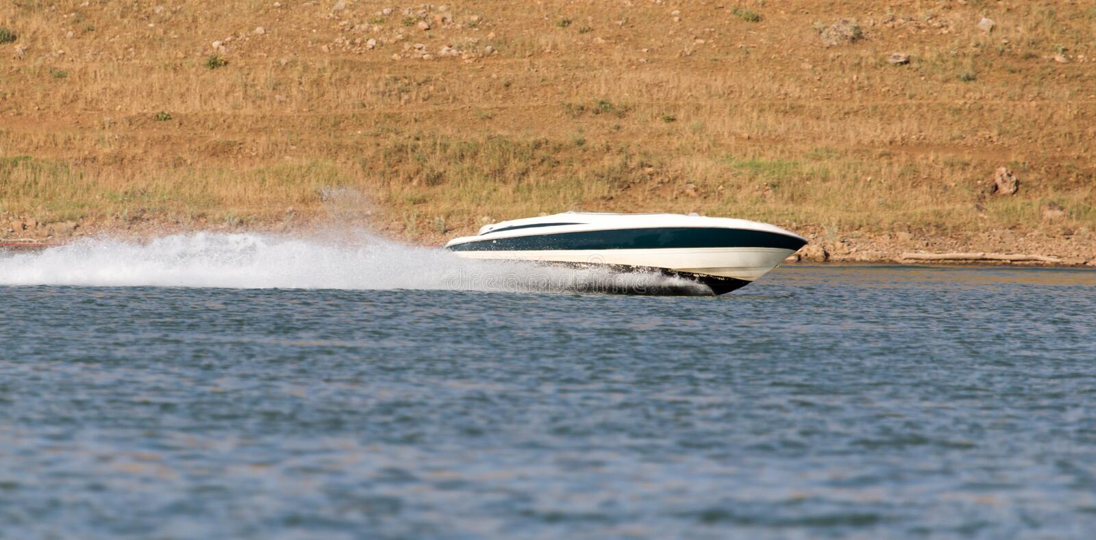 Boat floats on the lake speed. In the park in nature stock photo