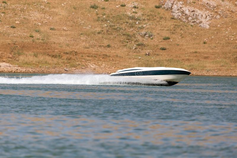 Boat floats on the lake speed. In the park in nature royalty free stock photography