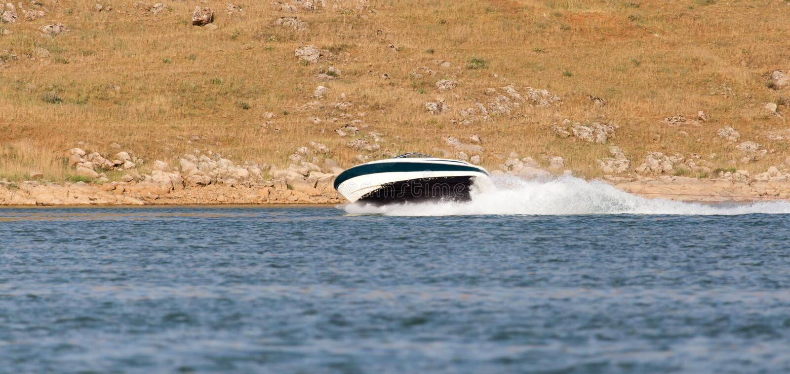 Boat floats on the lake speed. In the park in nature stock photos