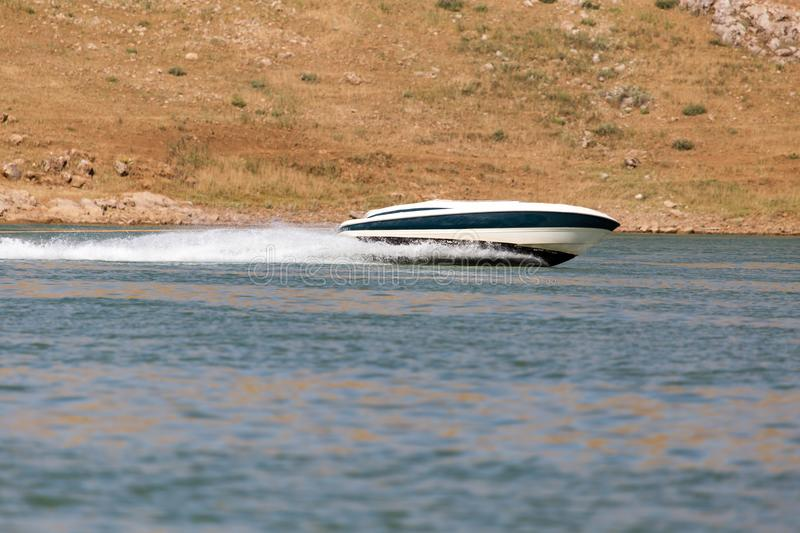 Boat floats on the lake speed. In the park in nature royalty free stock photos