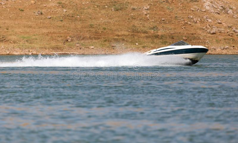 Boat floats on the lake speed. In the park in nature stock image