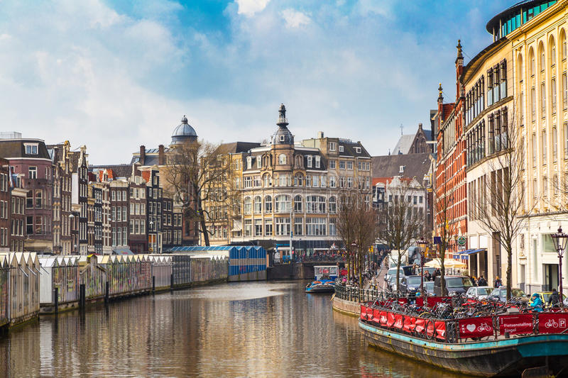 Boat and flower market, canal in Amsterdam, Holland royalty free stock images