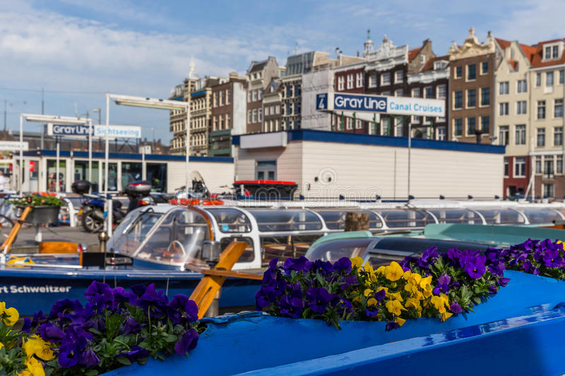 Boat with flowers at the harbor in Amsterdam stock photography