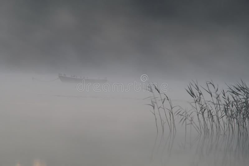 Boat in the fog royalty free stock photography