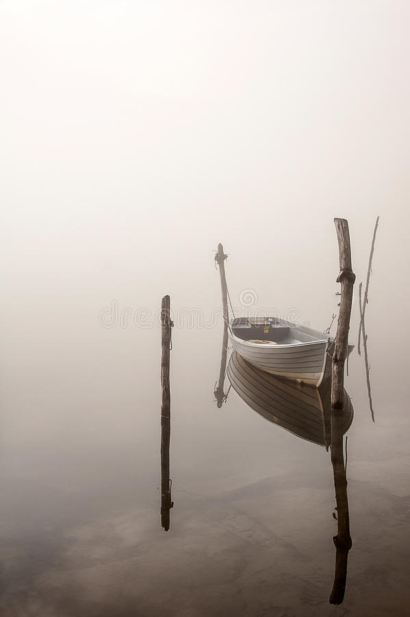 Boat in the fog stock photography