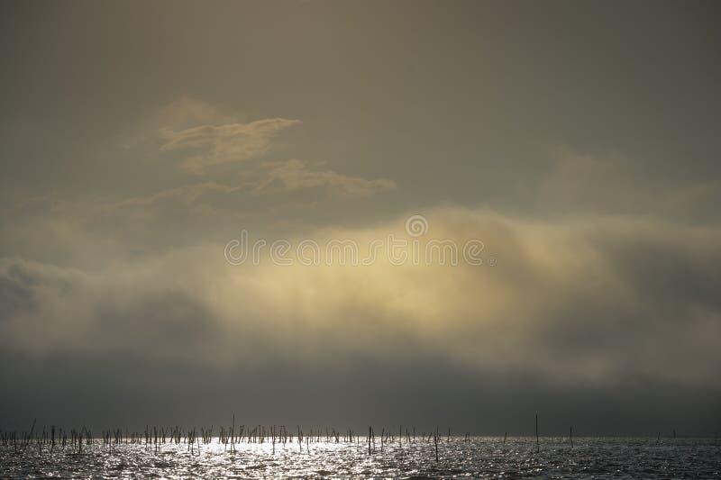 Boat in fog in ocean, Arcachon bay, Gironde, France stock photo