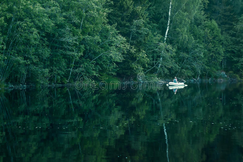 Boat on the forest lake stock images