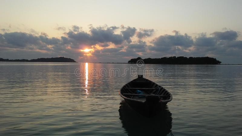 Boat in front of Ko Na Thian and Ko Mat Lang Islands during Sunrise on Koh Samui Island, Thailand. Boat in front of Ko Na Thian and Ko Mat Lang Islands during stock photography