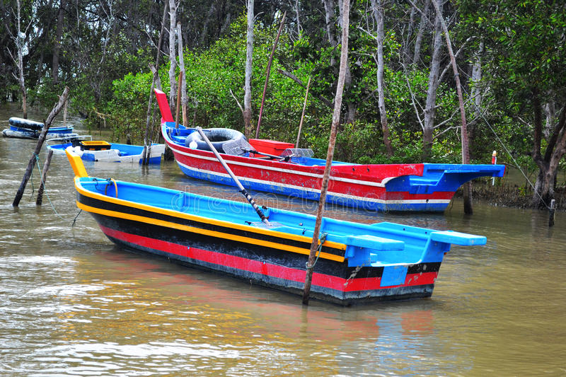 Boat ft estuary. A soothing scenery of a few boats at the estuary with the background of mangrove royalty free stock photo
