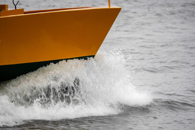 A boat in full speed over the water royalty free stock image
