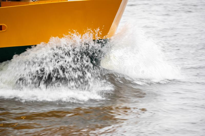 A boat in full speed over the water stock image