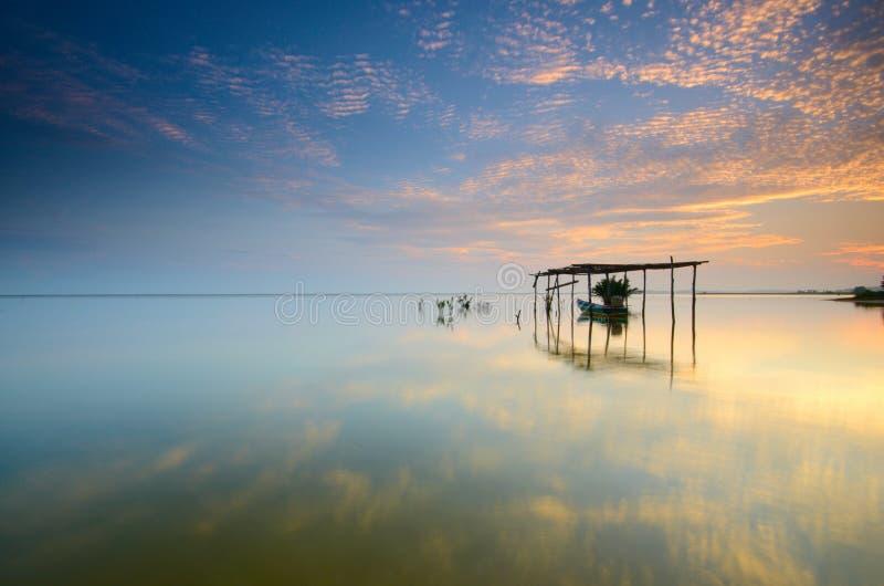 Boat on the garage at beautiful sunrise time.  Jubakar beach kelantan,  malaysia. Soft focus due to long exposure. stock image