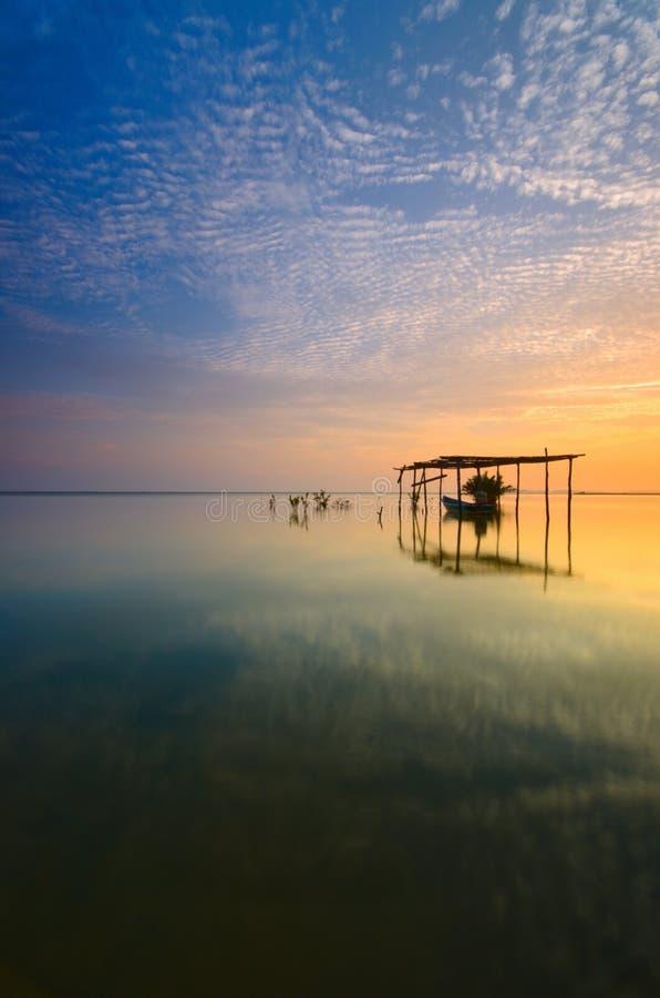 Boat on the garage at beautiful sunrise time.  Jubakar beach kelantan,  malaysia. Soft focus due to long exposure. stock images