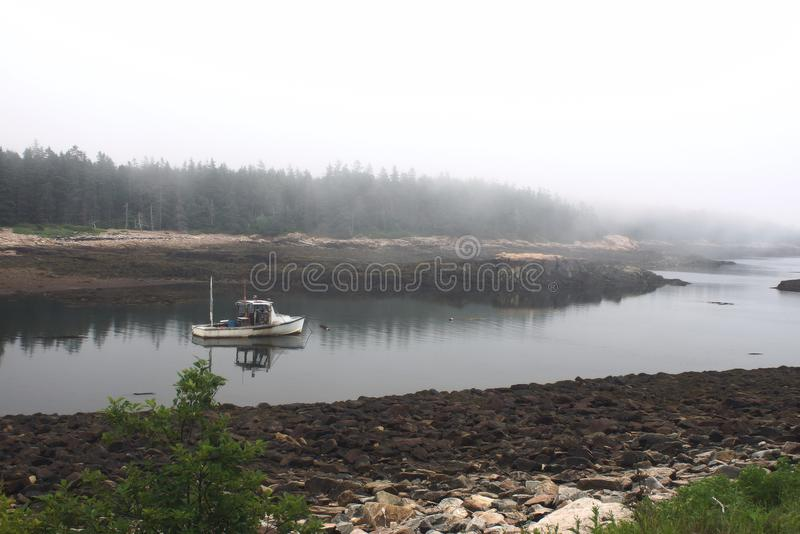 Boat going down river royalty free stock image