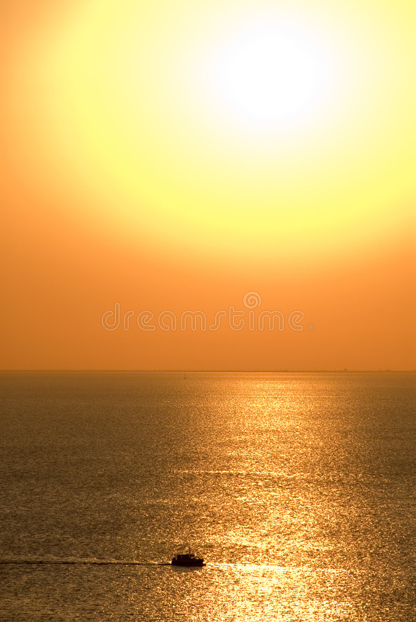 Boat in golden sunset royalty free stock photos