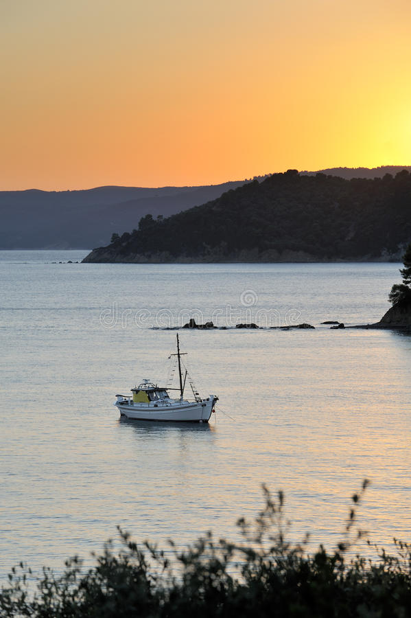 Boat in Greek archipelago during late afternoon royalty free stock photos