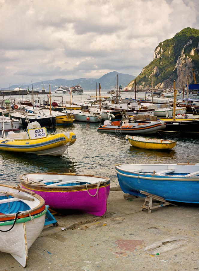 Harbor, Capri Town, Amalfi Coast, Italy. Small colorful boats, including boats for rent, fill the waters of the boat harbor in Marina Grande, on the Island of stock photos