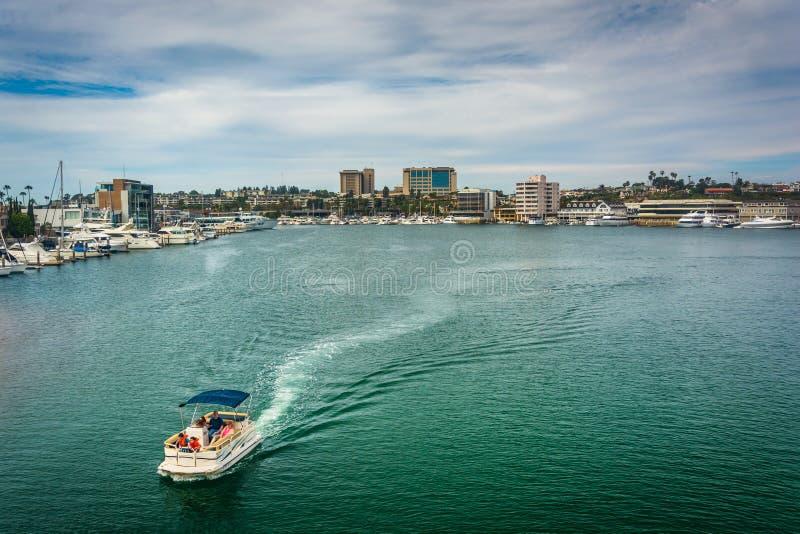 Boat in the harbor, seen from the Via Lido Bridge stock photo