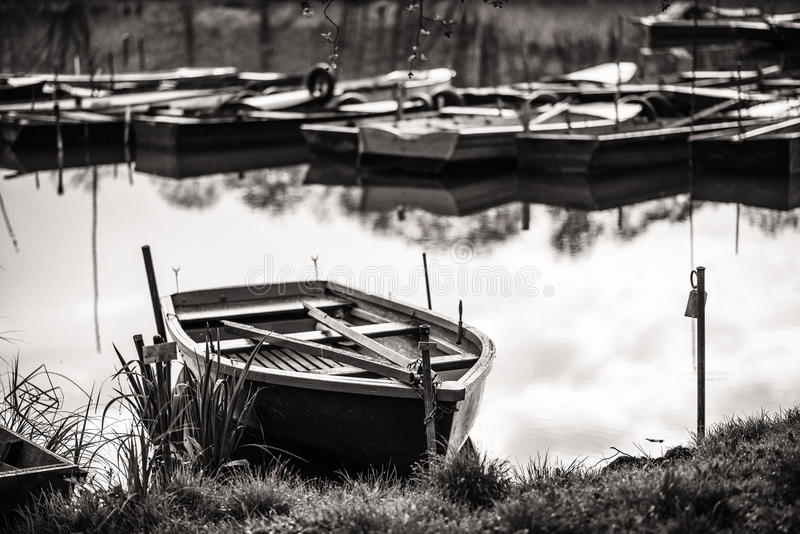 Boat Harbour - in black and white wood boats on the lake stock photography