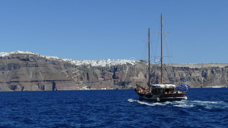 Download Boat Heading Towards The Town Of Fira In Santorini Editorial Photo - Image: 105252361