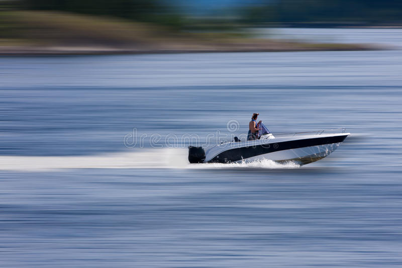 Boat at high speed. Boat cruising at high speed. Blurred background royalty free stock image