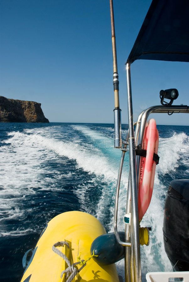 Boat at high speed. An inflatable boat travels at high speed royalty free stock photos