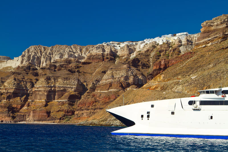 Download Boat At High Volcanic Cliff Of Santorini Island Royalty Free Stock Photos - Image: 26805508