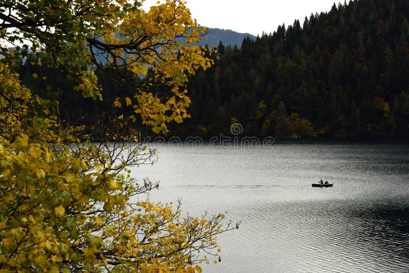 Boat on Hintersteinersee, Wilder Kaiser, Tirol, Austria. Autumn alpine scenery at Hinterstein lake under Wilder Kaiser mountains in Tirol - Austria royalty free stock image
