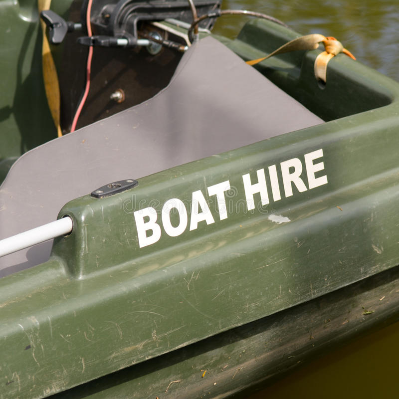 Boat for hire on river. Boat for hire sign on boat on river stock photos