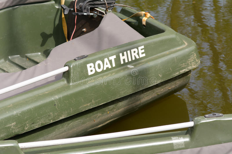 Boat for hire on river. Sign painted onto boat stock photo