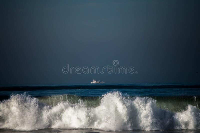 Boat on the Horizon stock photos