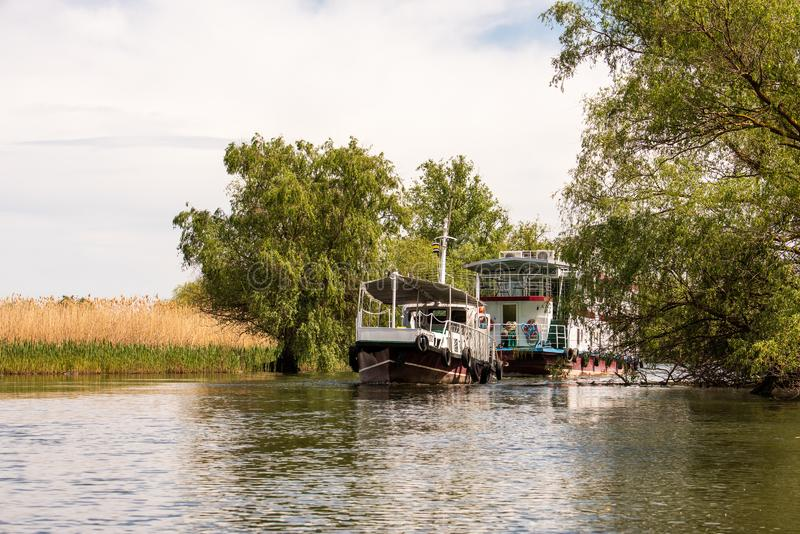 Boat Hotel adventure trip in Danube Delta ,  Romania wildlife bird watching.  royalty free stock photo