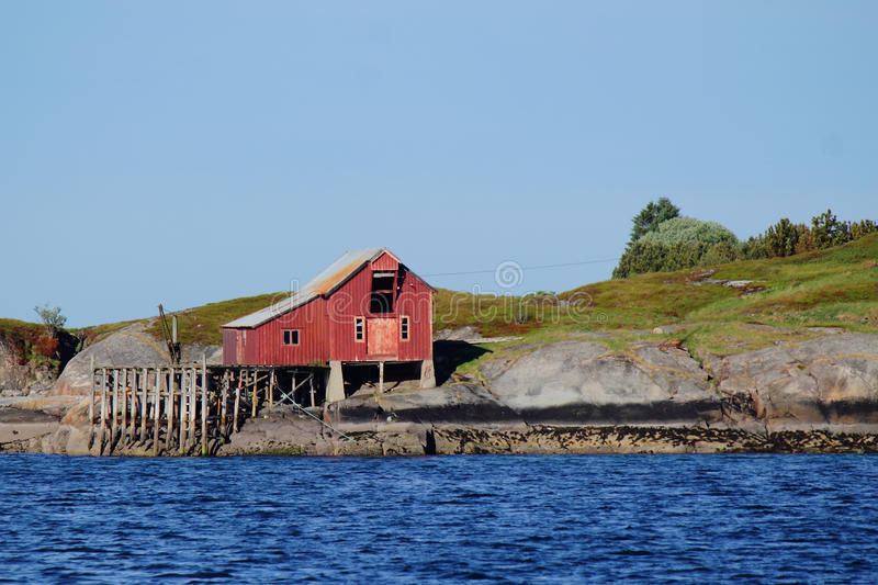 Boat house of Bolga. Old fishermen's cabin ofthe island of Bolga , Norwegian polar circle royalty free stock images