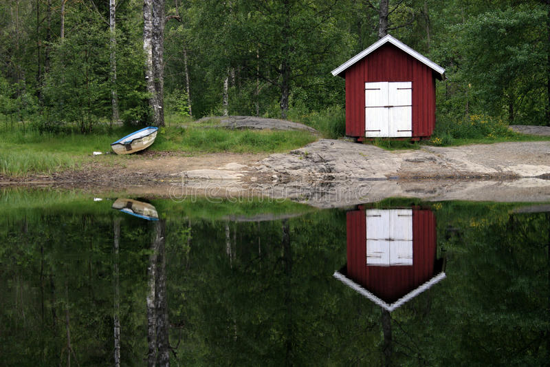 Boat house reflecting on lake royalty free stock images