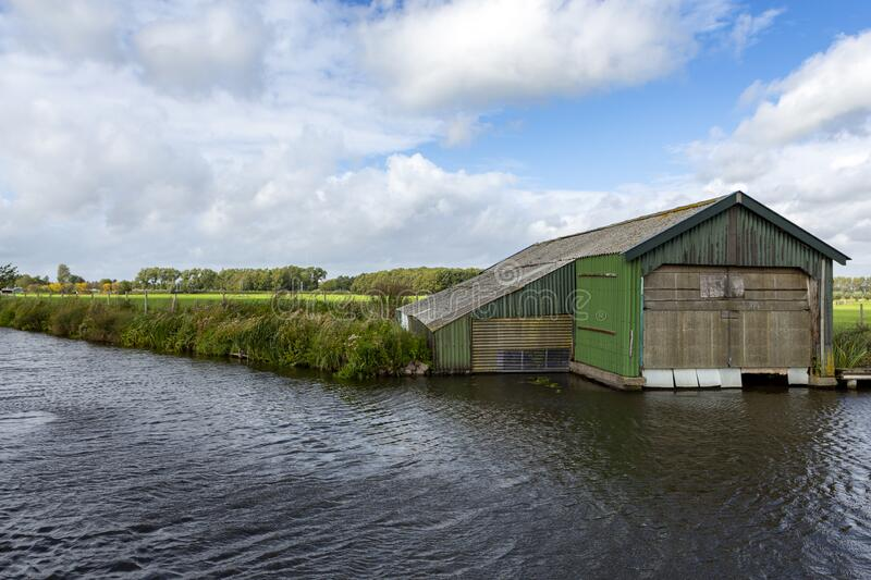 Boat house on the ringsloot in Warmond, the Netherlands. royalty free stock image