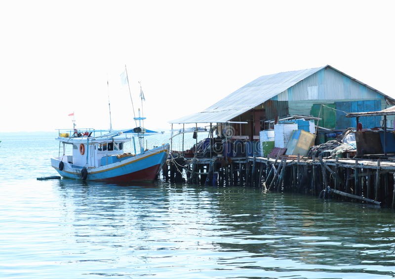 Boat by a house in Sorong. Fishers boat parking by a house of fisherman in Sorong (Papua Barat, Indonesia stock photos