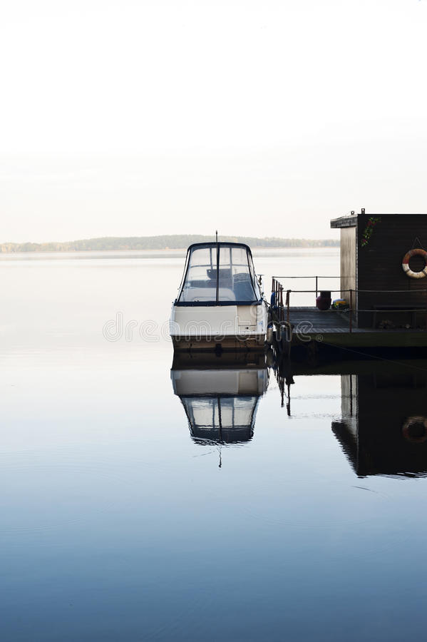 Download Boat And Houseboat On Calm Morning Lake Stock Image - Image: 36518337