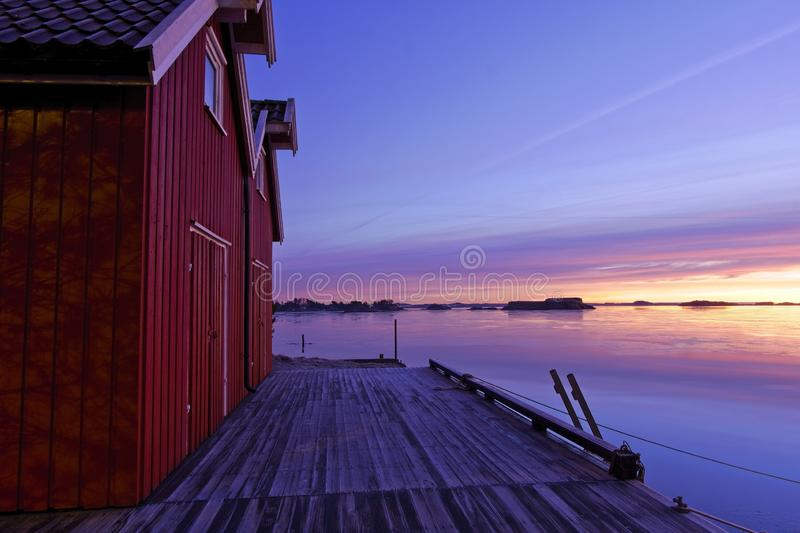 Boat houses by the fjord in beautiful morning light royalty free stock photo