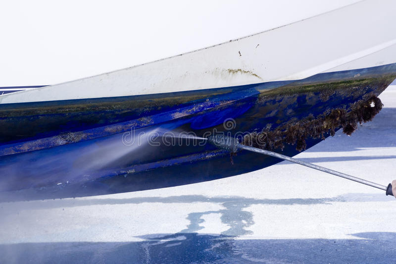 Boat hull cleaning water pressure washer royalty free stock images