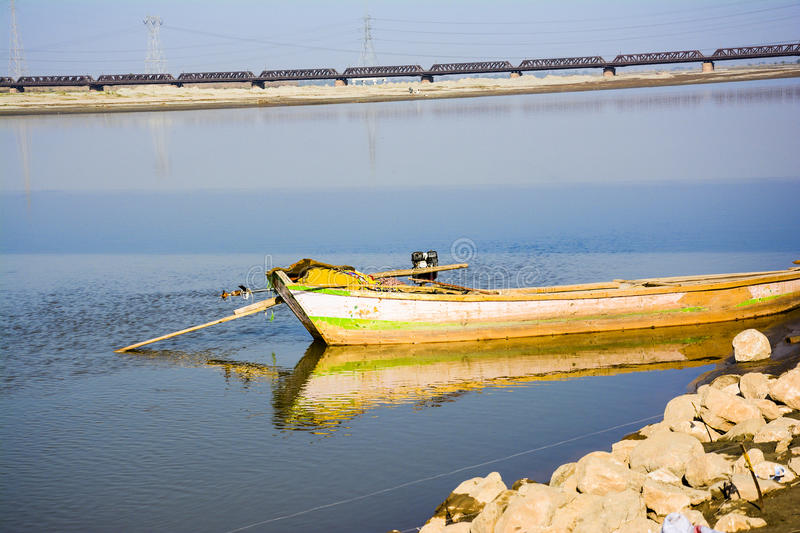 Boat in Jhelum River. Khushab Bridge, Punjab, Pakistan. Old rail track bridge can also be seen in the image. Jehlam River or Jhelum River is a river that royalty free stock images