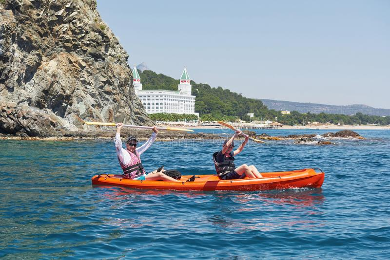 Boat kayaking near cliffs on a sunny day. Kayaking in a quiet bay. Amazing views. Travel, sports concept. Lifestyle. A royalty free stock photography