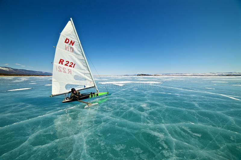 Boat for kitewing frozen ice on a beautiful lake on a background of blue sky royalty free stock images