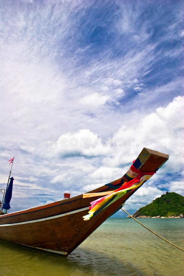 Boat in the lagoon. Thai boat on blue sky background royalty free stock photo